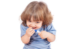 Little girl brushes her teeth, isolated Stock Image