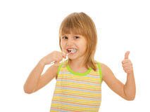 Little girl brushes teeth Royalty Free Stock Images