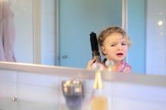 Little girl brushing her hair Stock Photography