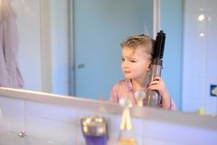 Little girl brushing her hair Royalty Free Stock Photo
