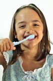 Little Girl Brushing her Teeth Stock Images