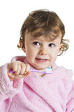 Little girl brushing her teeth Stock Image