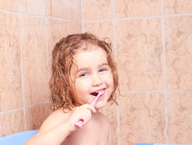 Little girl brushing her teeth Stock Photo