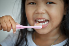 Little girl brushing her teeth close up on toothbrush Royalty Free Stock Photo
