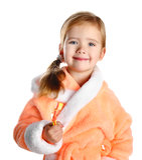 Little girl brushing her teeth isolated Stock Photography