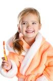 Little girl brushing her teeth isolated Stock Image