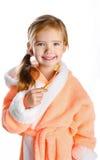 Little girl brushing her teeth isolated Stock Photos