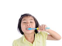 Little girl brushing her teeth isolated Stock Photos