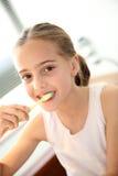Little girl brushing her teeth Stock Images