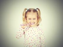 Little girl brushing her teeth. Stock Photo
