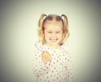 Little girl brushing her teeth. Stock Image