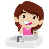 Little Girl Brushing her teeth Stock Image