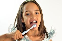 Little Girl Brushing her Tongue Stock Image
