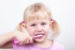Little girl brushing teeth Stock Photography