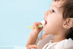 Little girl brushing teeth Royalty Free Stock Photo