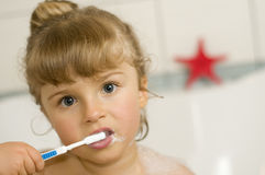 Little girl brushing teeth Stock Photos