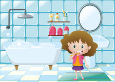Little girl brushing teeth in bathroom Stock Image
