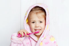Little girl brushing teeth. Little girl brushing her teeth Royalty Free Stock Photo