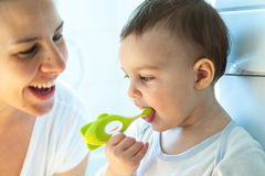 Little girl is brushing teeth with her toothbrush Royalty Free Stock Image