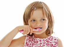 Little girl brushing teeth isolated Royalty Free Stock Images