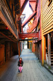 Little girl in Bryggen Village. A young girl standing on the walkway of Bryggen Village in Bergen, Norway Stock Photography