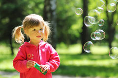 Little girl with  bubble Stock Photography