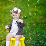 Little girl with bubble blower in a park Stock Photo