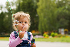 Little girl and the bubbles Royalty Free Stock Photos
