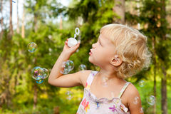 Little girl with bubbles Stock Image
