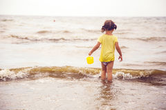 Little girl with a bucket Royalty Free Stock Photography