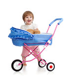 Little girl with buggy and kitten inside Royalty Free Stock Images