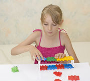 Little girl build construction Royalty Free Stock Images