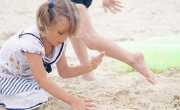 Little girl build a sand tower. Little Latin girl build a sand tower. Seaside vacation Royalty Free Stock Images
