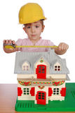 Little girl builder Stock Photo