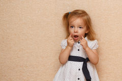The little girl is building faces. royalty free stock photography