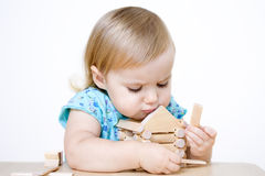 Little girl building house Stock Images