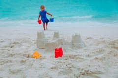 Little girl building sand castle on beach Stock Image