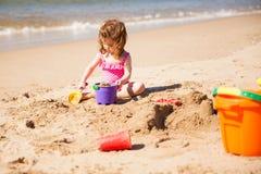 Little girl building sand castle Royalty Free Stock Image