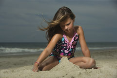 Little Girl Building Sand Castle Royalty Free Stock Photo