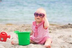 Little girl building sandcastle on tropical summer beach Stock Photo