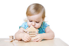 Little girl building toy house Royalty Free Stock Photo