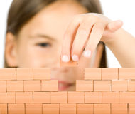 Little girl building a wall Royalty Free Stock Photo