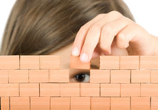 Little girl building a wall Royalty Free Stock Photography