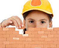 Little girl building a wall Stock Photo