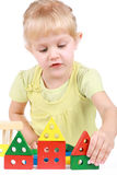 Little girl builds a designer Stock Photos
