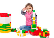 Little girl builds a tower Royalty Free Stock Photos