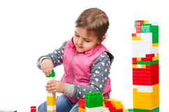 Little girl builds a tower Stock Images