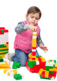 Little girl builds a tower Royalty Free Stock Images