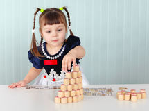 Little girl builds tower of lotto Stock Image