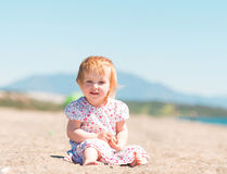 Little girl  builds a tower of sand Royalty Free Stock Photo